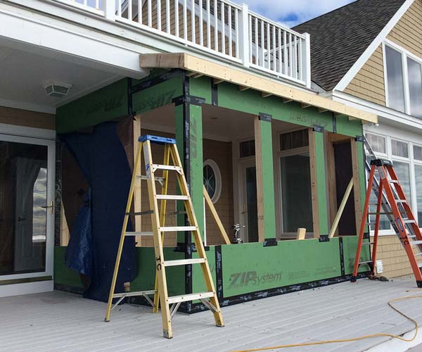 Wall and roof work continues on this seaside porch enclosure project located in York, Maine
