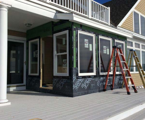 New windows and protective sheathing have been added to this porch enclosure