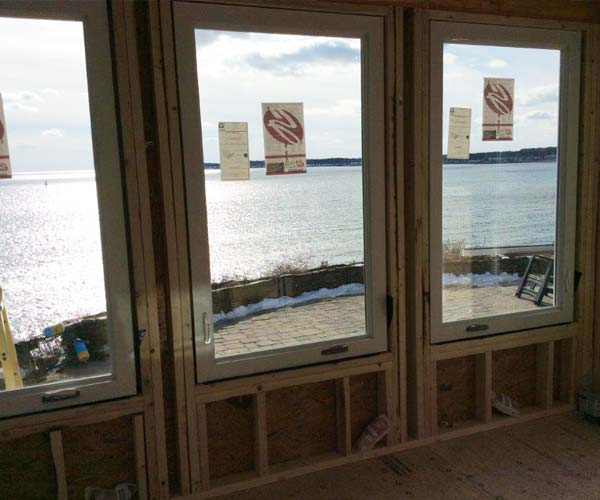 A view from the interior of the porch enclosure project showing the shining Atlantic Ocean