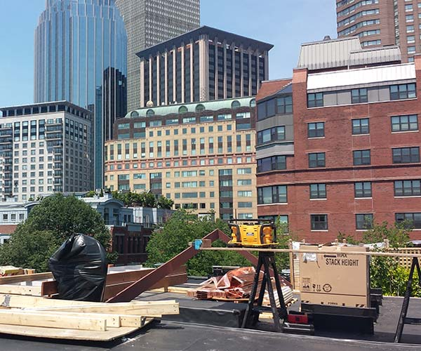 The Sunspace Design Boston roof construction site has been staged in preparation of the glass roof structure assembly