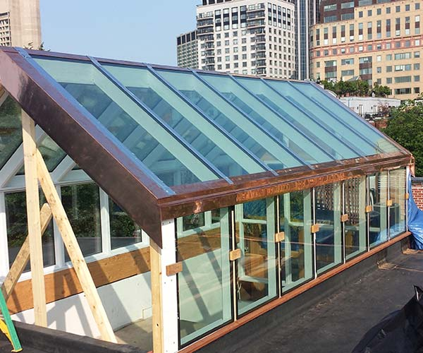 The glass skylight structure has been outfitted with glass along the sloped roof and clerestory wall sides
