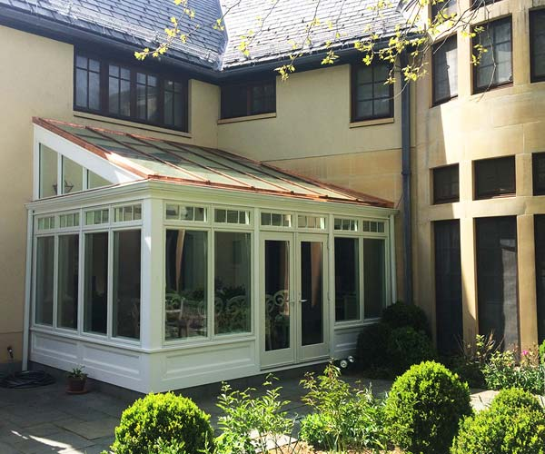 A view of the completed Weston residential glass conservatory with an adjoining patio area