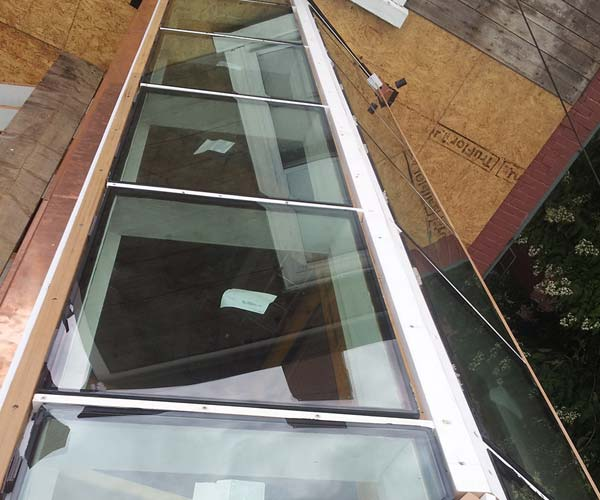 These shining panes of glass indicate that this phase of the roof system's assembly is complete