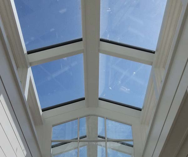 The custom glass roof lantern allows massive levels of natural sunlight to enter the space below