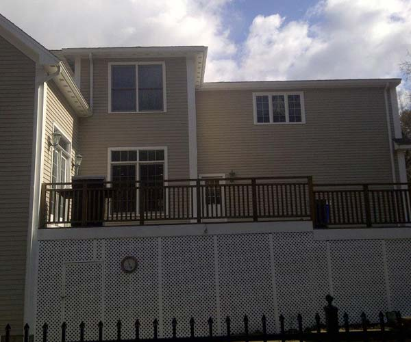 %22Before%22 photo of the exterior wall planes that Sunspace Design will be tying their residential sunroom into