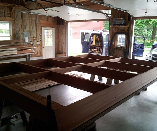 A sloped glazing frame constructed out of solid mahogany in the Sunspace Design shop