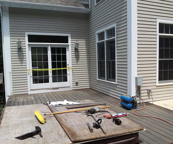 A luxury jacuzzi has been installed in the client's deck before the sunroom enclosure is added