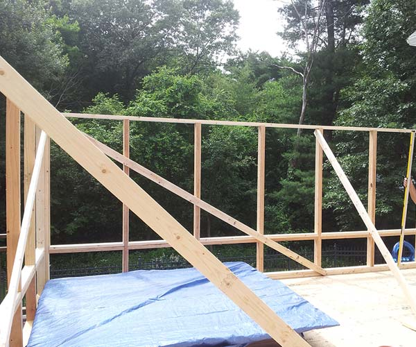 Additional sunroom wall frames have been added to establish the final footprint of the new deck enclosure
