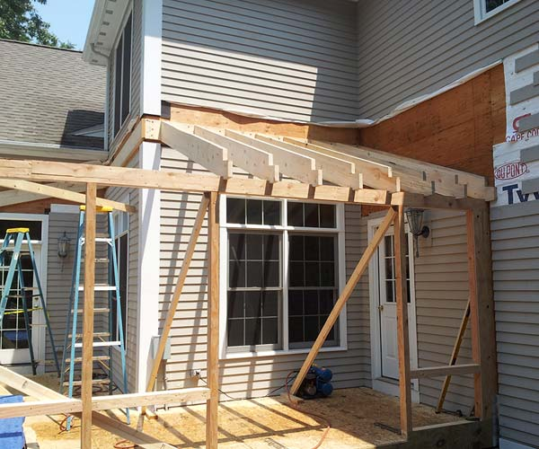 The conventional roof frame's rafters are added after careful planning