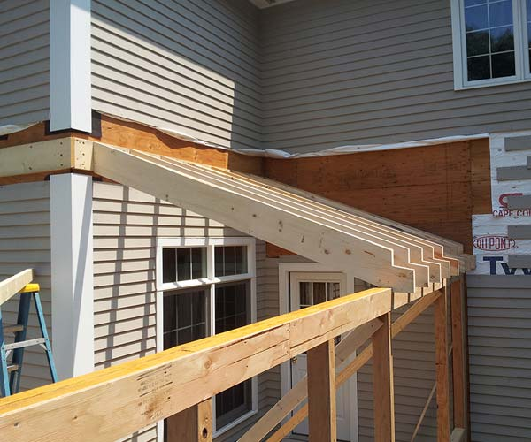 An eave cut on the rafters will ensure consistent flashing in this sunroom deck conversion project