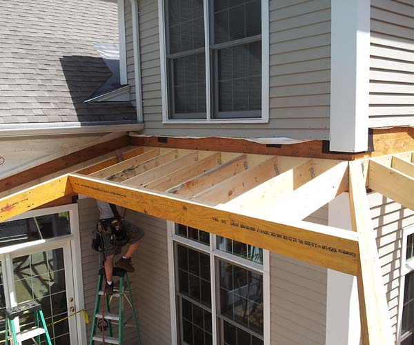 The rough opening for the sunroom's glass roof section is visible in this photograph