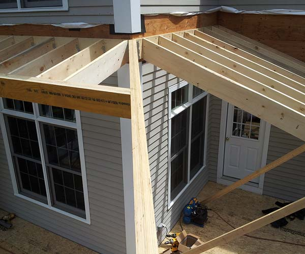 The LVL hip rafter has had its top beveled to ensure a smooth transition between the two adjacent sunroom roof slopes