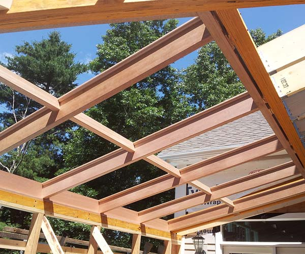 An alternate angle of the sloped glazing unit frame that reveals the amount of glass roof area that will be present in the finished sunroom addition