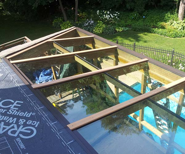 The sunroom's glass roof section above the hot tub receives large glass panes