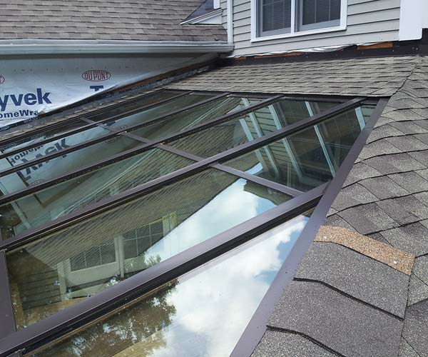 Work on the flashing, glazing caps,and sealants of the glass roof section has completed