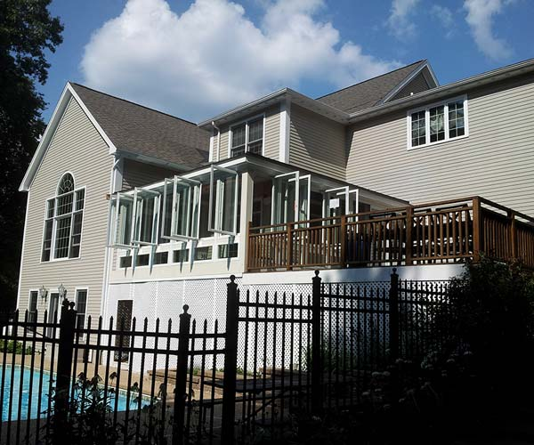 An exterior photograph of the completed Dover, Massachusetts sunroom deck conversion project