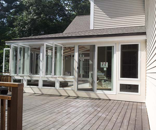 A view of the entry to the new sunroom addition from the adjacent deck area