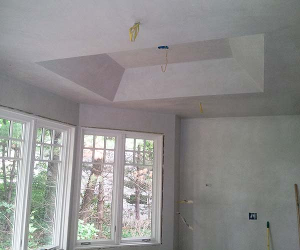 The tray ceiling of this kitchen renovation is nearly complete