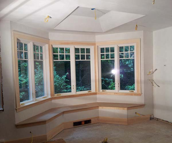 This interior photo of the project shows that trim is complete, but flooring, paint, and electrical work are still to come