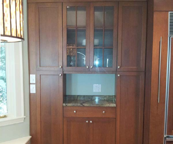 A custom milled pantry unit fits perfectly in the wall space of this residential kitchen project