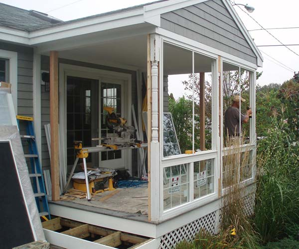 This view of a York, Maine porch renovation project features an exterior look of a new front wall system
