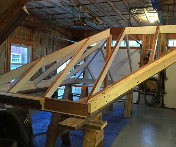 A look at a glass roof system being framed in mahogany under construction at the Sunspace Design workshop