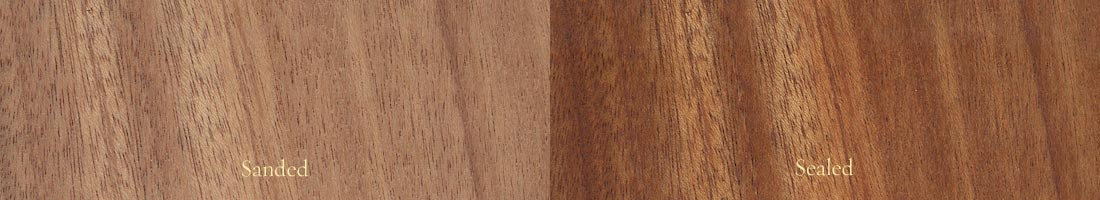 The grain of African mahogany, with a sanded panel on the left and a sealed panel on the right