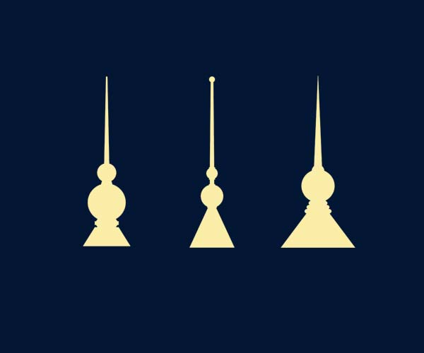 A panel of three decorative finial silhouettes which depict classic styles with triangular bases, spherical midsections, and pointed spires