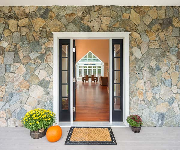The home addition (a glass conservatory) is visible from the entryway of the home, creating a stunning effect