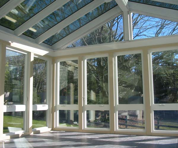 This Topsfield, Massachusetts sunroom space featuring slate floors and reflective glass has yet to be filled by the client
