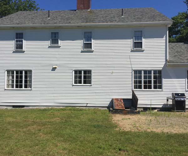 A look at the rear of a York, Maine residential home before a new home renovation project begins