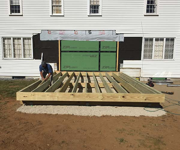 A photo of the brand new floor framing that will soon support a custom Sunspace Design glass conservatory and skylight roof system