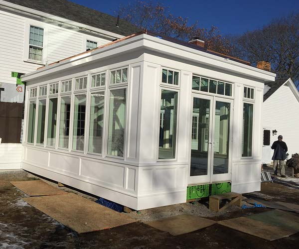 The exterior details of the conservatory have come together as the crew prepare finishing touches and begin cleaning up the project site