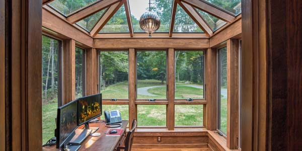 A photograph of the interior of a gorgeous mahogany four season office conservatory located in North Hampton, New Hampshire