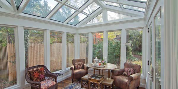A photograph of the interior of a four season glass conservatory custom designed and built by Sunspace Design in Cambridge, Massachusetts