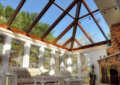 Custom Conservatory Interior with Fireplace and Glass Roof