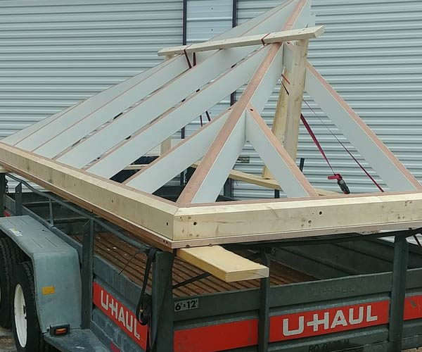 The first section of a glass roof frame has been loaded onto a cart for transportation to the residential construction job site in Concord, Massachusetts