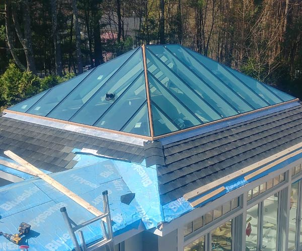 Pristine panes of Solarban 90 high performance insulated glass are installed across the surface of this mahogany glass skylight frame