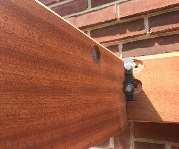 An embedded steel ridge has been concealed by mahogany trim to improve aesthetics without losing durability or strength