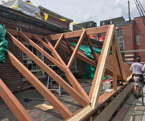 The dormer valley frame of this custom glass roof project has been completed