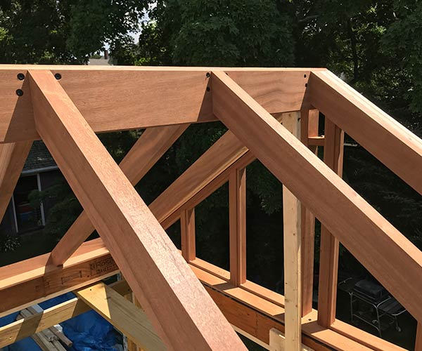 A close-up look at the custom home addition's solid mahogany rafters