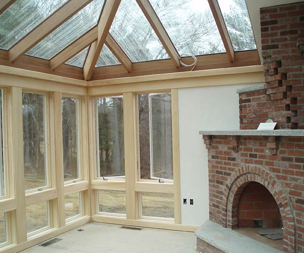 Paint will soon be applied to the interior of this conservatory; white unpainted walls are visible in the photograph