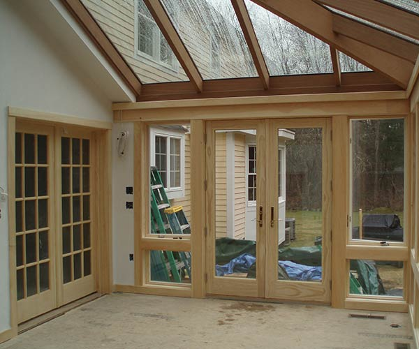 French doors connect the conservatory to both the interior of the home (via the dining room) and the exterior of the home (via the brand new deck)
