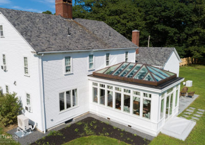 An iconic conservatory with a custom glass roof framed in mahogany, seen from above
